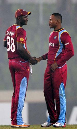 West Indies captain Darren Sammy congratulates Marlon Samuels after the match.