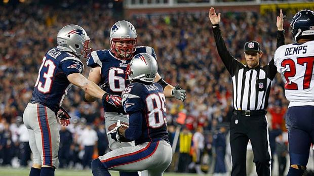 Brandon Lloyd (85) of the New England Patriots celebrates his touchdown with Wes Welker (83) and Dan Connolly (63).