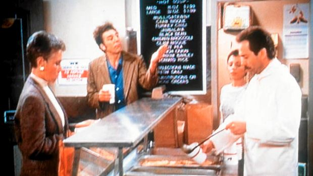 """A still from a Seinfeld episode featuring the """"Soup Nazi"""" (right)."""