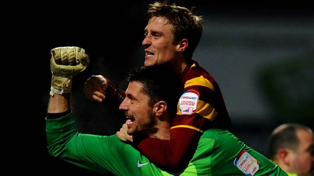 Giant-killers .... Bradford goalkeeper Matt Duke is congratulated by teammate Stephen Darby.