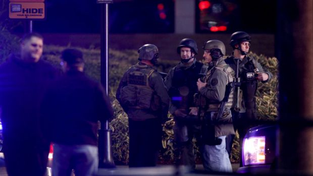 Law enforcement personnel work the scene of a shooting at the Clackamas Town Center in Clackamas, Oregon.