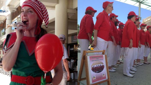 A roving entertainer and carollers in Perth city.