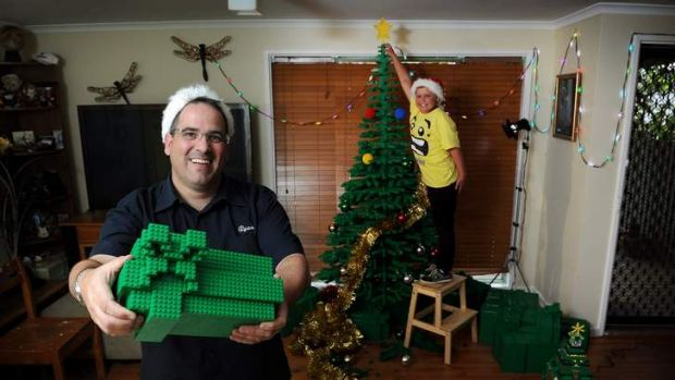 Oliver McLauchlan, 9, with the 2m by 1.5m LEGO tree that Ryan McNaught, left, built.