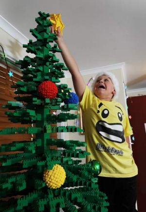 Oliver McLauchlan, 9, gives his LEGO tree the finishing touch.