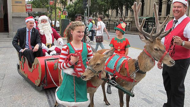 Brisbane Lord Mayor Graham Quirk gets into the Christmas spirit in the Queen Street Mall.