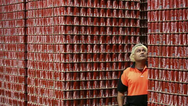 Coke says says volume and earnings in the company's Australian business was solid given a difficult trading environment.