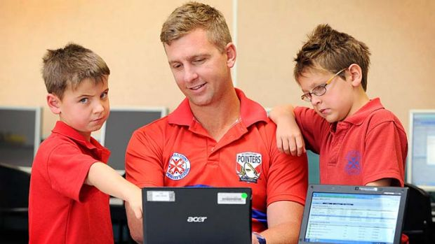 Nichols Point Primary teacher Troy Moncur with Brodie Rayson (left) and Sage Malcotti.