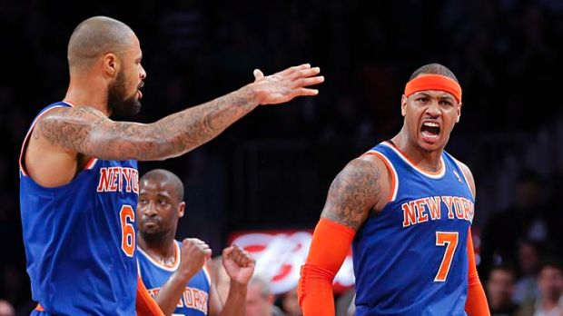 New York Knicks forward Carmelo Anthony (7) and teammate, centre Tyson Chandler (6), after Anthony scored a three-pointer.