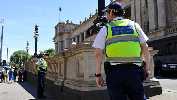 Protective services officers outside Parliament House.