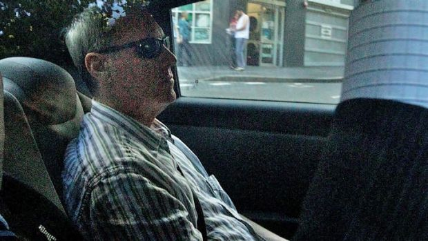 Facing charges ... Robert Hughes arrives at Surry Hills Police Centre.