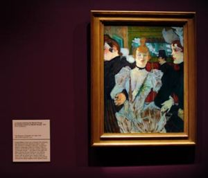 <i>La Goulue entering the Moulin Rouge</i> hanging on the NGA's walls.