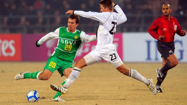 Homeward bound ... Joel Griffiths in action for Beijing Guoan against Melbourne Victory in the Asian Champions League in ...