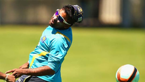 It ain't cricket ... Sri Lanka's Mahela Jayawardene gets in some round-ball practice of another kind at Bellerive on ...