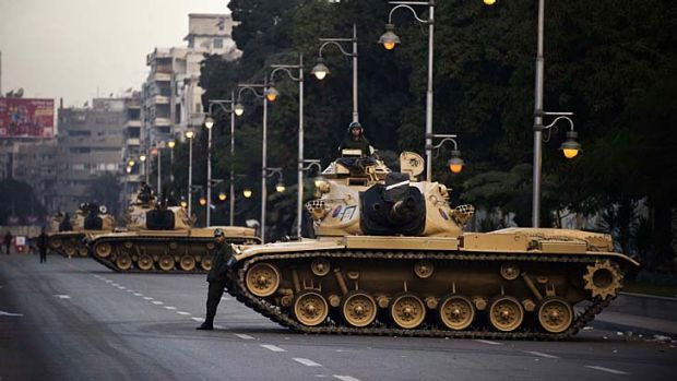 Egyptian army tanks deployed outside the presidential palace in Cairo.
