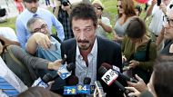 Tycoon McAfee in US after deportation (Video Thumbnail)