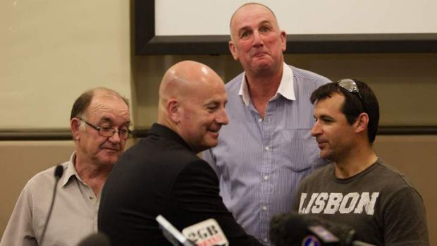 Three heroes ... NSW Opposition Leader John Robertson congratulates (from left) Glen May, Gordon Cameron and Nuno Nunes ...