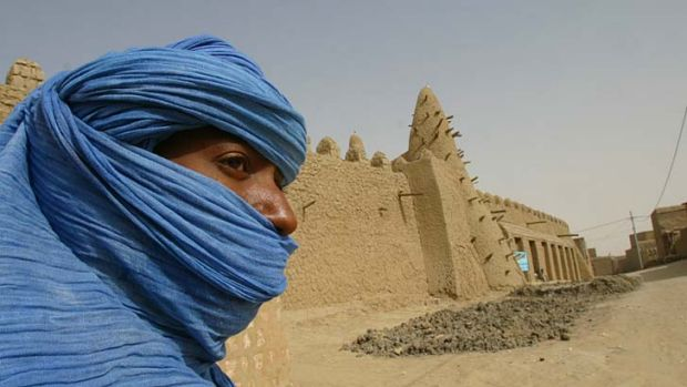 Thousands flee … a Tuareg nomad near a mosque in Timbuktu, where Islamist radicals have taken over.