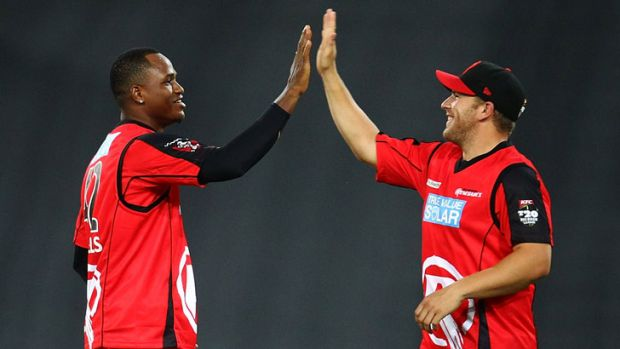 High fives: Marlon Samuels and Aaron Finch celebrate a wicket during the Renegades' win on Friday night.