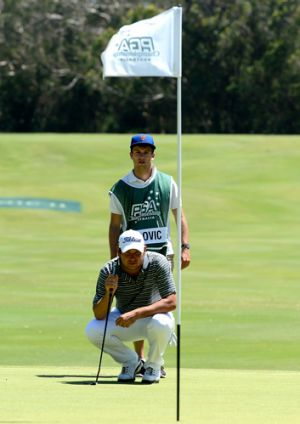Daniel Popovic sizes up a putt at the 12th hole yesterday.