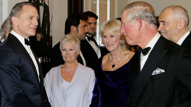 <em>Skyfall's</em> Daniel Craig and Judi Dench hobnob with royalty.