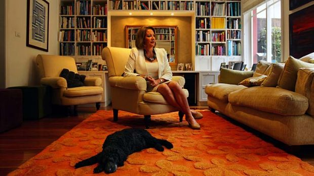 Bookish type ... Liz Broderick at her Hunters Hill family home with Billy, the ageing family poodle.