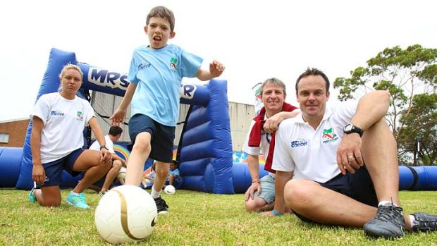 Emphasis on fun … a Marrickville Public School pupil with, from left, Matildas striker Kyah Simon, the head of the ...