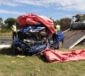 A wrecked car in which four people died near Lara (left) after a collision with another vehicle being driven the wrong ...