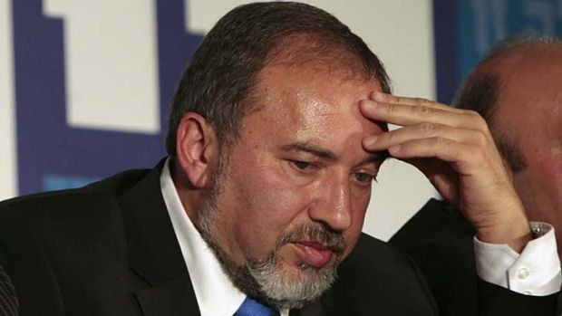 Resigned ... Avigdor Lieberman vows to clear his name.