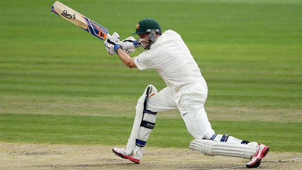 On the drive ... Mike Hussey sends another Sri Lankan delivery hurtling through the covers during his eventful century ...