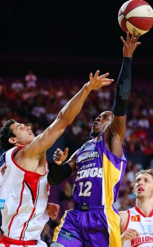 Flying … Corin Henry of the Kings shoots against the Hawks.