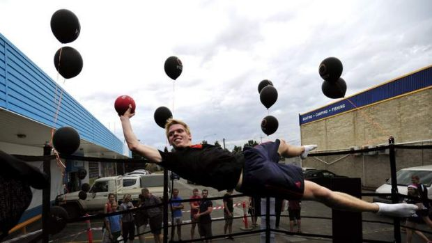 Trampoline athlete Matthew Weal puts on a demonstration of his skills in Canberra as part of the Vuly's Olympic Tour.