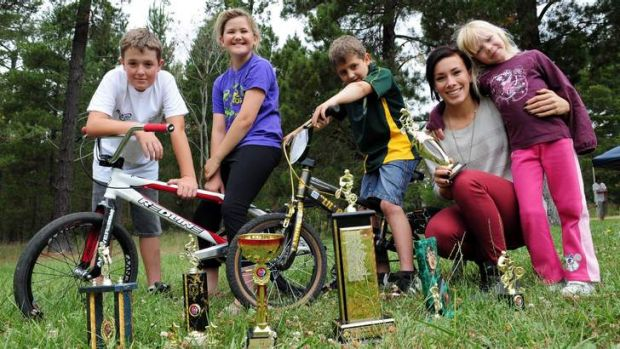 BMX champion Caroline Buchanan, second from right, spent time at Fadden Pines to present end of year trophies to members ...
