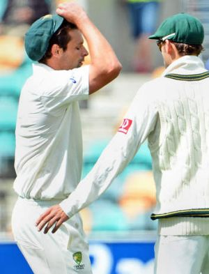 Australia's paceman Ben Hilfenhaus (left) reacts as he leaves the field injured against Sri Lanka as teammate Nathan ...