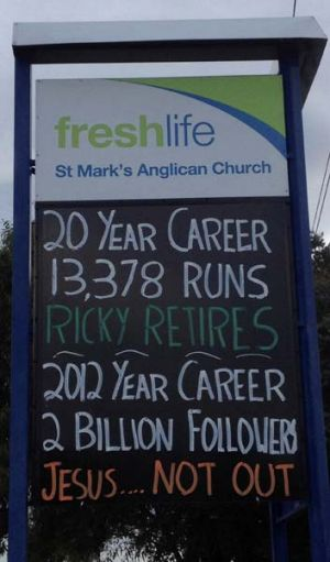 Hero worship … a sign outside a church near Bellerive Oval.