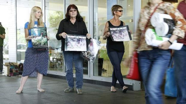 From left, Animal Liberation ACT members Jessica Hare, Carolyn Drew and Benice Richmond appeal to shoppers at the ...