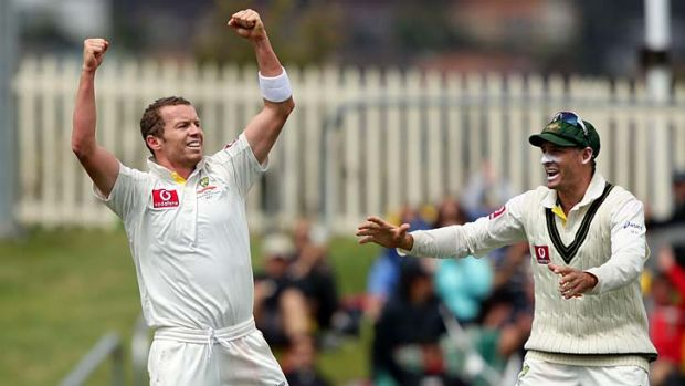 Flexed his muscle … Peter Siddle tore through the Sri Lankan tail to end with figures of 5-54.