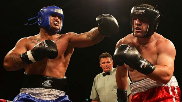 Punching on … Sharks skipper Paul Gallen works the body of Hika Elliot in his boxing debut.