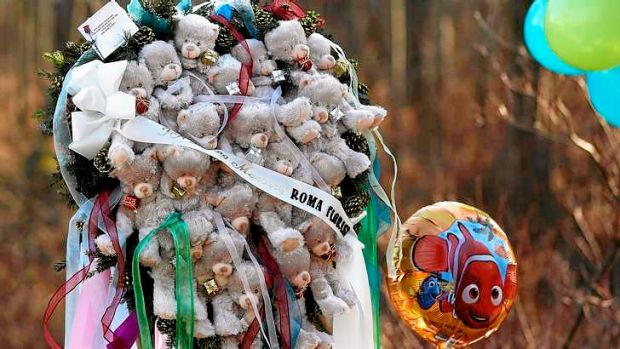 Remembering the dead … part of a makeshift memorial in Sandy Hook, Connecticut. All the children killed were six ...