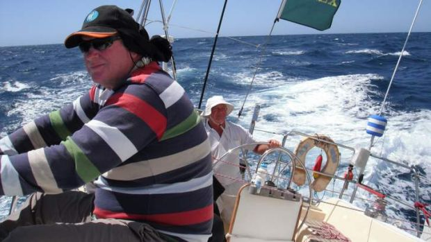 Ian Cooke, left, and Noel Sneddon at the helm of Inca as it enters Bass Strait.