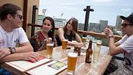 Summer Herald - Backpacker's perfect day. Morning Beers in The Rocks. Friday 23rd November 2012. Photograph by James ...