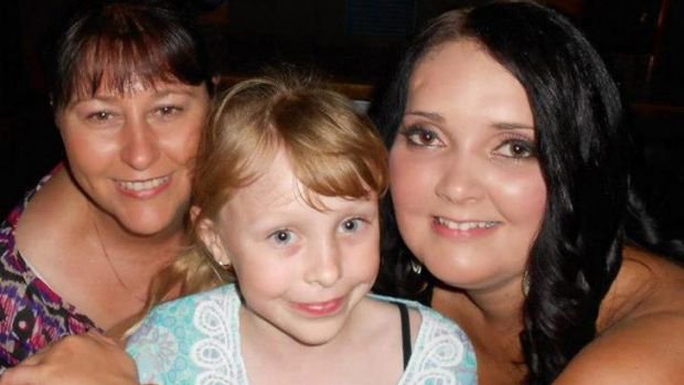 Karrisa McDonald (centre), pictured with her sister and mum, died after being hit by an umbrella picked up by a gust of ...
