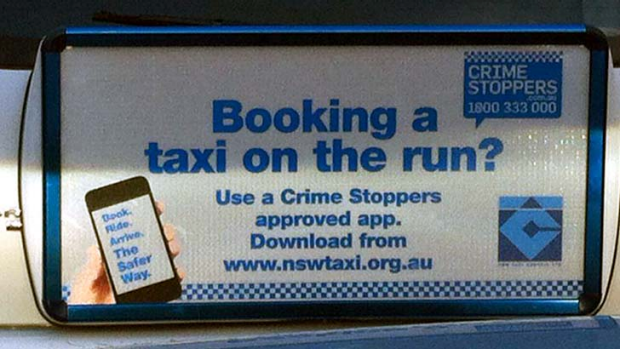 The ad running on the back of cabs around Sydney, part of a campaign paid for by the NSW Taxi Council.