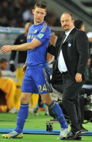 Rafael Benitez consoles Chelsea defender Gary Cahill after he received a red card during the Club World Cup final.