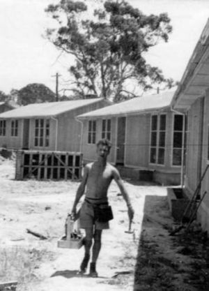 Klaus Scharrer working in the heat at house in Sundew Crescent, O'Connor.