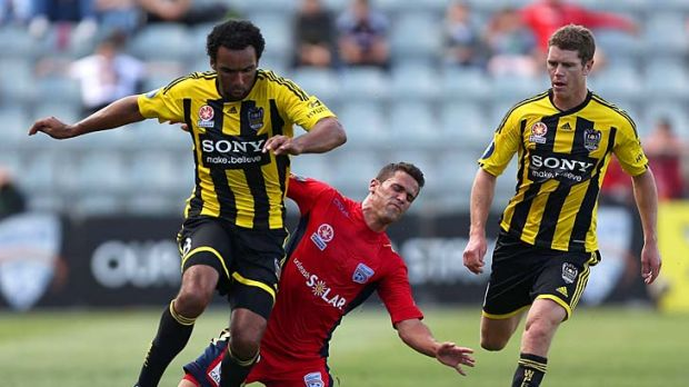 Not happy: Wellington Phoenix striker Paul Ifill (left) was at the receiving end on Sunday.
