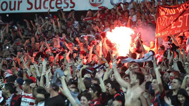 On fire ... Western Sydney Wanderers fans during the Sydney derby.