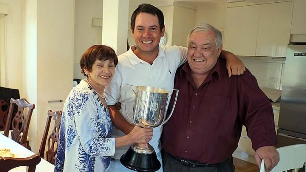 Champion ... Popovic with his parents.