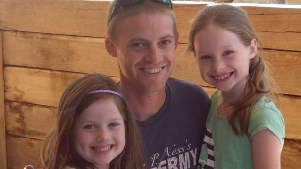 Grant Kirby with daughters Isabella and Madeleine.