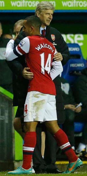 I won't let go: Theo Walcott and Arsene Wenger.