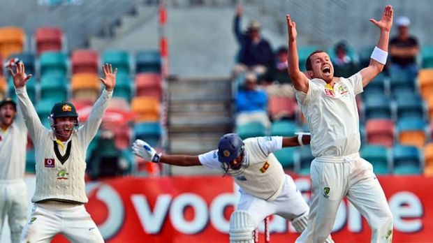 Big day: Peter Siddle traps Thilan Samaraweera leg-before and was later cleared of ball tampering.